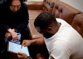 James Francies checking Hiro Honshuku's transcription